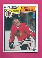 1983-84 OPC # 105 HAWKS STEVE LARMER  ROOKIE ERROR EX+  CARD (INV# C8115)