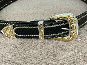 BROWN LACED LEATHER BELT SIZE 40 WITH (3) PIECE GOLD/SILVER BUCKLE SET & CONCHOS