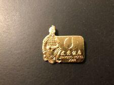 "Vintage ""JIANGUO HOTEL XIAN"" Gold Plated Aluminum Pinback Button 1 1/8"""