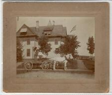 Photograph of a wagon and horses outside a house somewhere in USA (C29289)