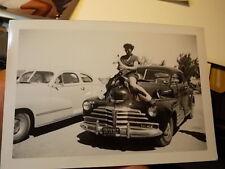 VINT SNAPSHOT PHOTO, WOMAN MOUNTS HOOD OF CALIFORNIA CAR PLAYING HORSEY