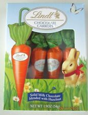 LINDT CHOCOLATE CARROTS--LOT OF 2 --SOLID MILK CHOCOLATE BLENDED WITH HAZELNUT.