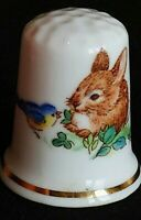 BABY RABBIT AND TWEETY BIRD SHARING LEAVES ILLUSTRATED CHINA SOUVENIR THIMBLE