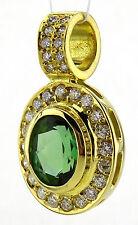 Anhänger, 585 / 14k Gold, Turmalin grün ca. 3,6 ct., mit Brillanten 0,50 ct.