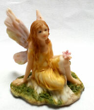 Fairy Figurine Yellow Dress Pink Wings Flower Sitting in Grass Resin 3""
