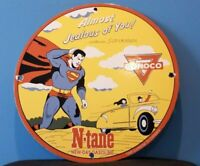 VINTAGE CONOCO SUPERMAN GAS PORCELAIN GASOLINE AND OIL COMIC PUMP PLATE SIGN