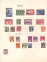 13 old CANADA + 10 old CEYLON stamps on an album page.