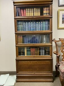 globe wernicke bookcase. Mfg UK. Base, Crown, Four Glass doors, One Wooden Door