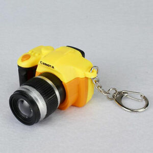 Mini toys, camera charm, flash and sound gifts, key chains, key rings