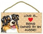 Love is...Being owned by a Aussie! Cute Pawprints Heart Dog Sign 10x5 Wood 842