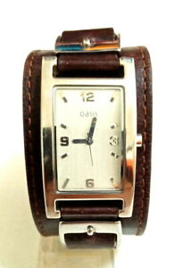 LADIES SILVER TONE OASIS WATCH ON A WIDE BROWN GENUINE LEATHER STRAP.