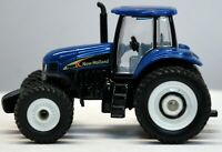 ERTL 1/64 Scale New Holland TG 285 Tractor w/Duals, Introduction Edition; Mint