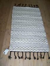 Läufer Teppich Madam Stoltz 125 x 73 cm schwarz weiß Pompon Boho