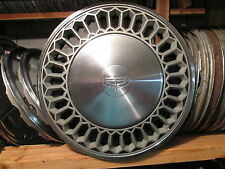 one 1974 to 1976 Mercury Cougar deluxe hubcap wheel cover