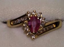 14KT YELLOW GOLD RING WITH PINK SAPPHIRE AND DIAMONDS SIZE 6.75