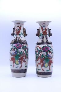 A Pair of Antique Vases with Colorful Warriors