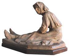 Terre cuite vieille femme assise par Rigal daté 1920