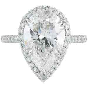 Featuring a 5.05 Pear Shape Center Natural CZ With Round Cut CZ Halo Women Ring