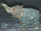 Elefant aus Metall mit zahlreichen kunstvollen Verzierungen, klein