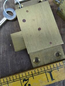 """Solid brass surface mounting cabinet lock with key 1 3/8"""" x 3"""".... .old stock."""