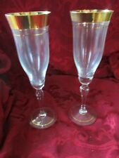 Wide gold band pair of champagne toasting flutes wedding