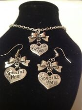 special nan bow necklace and matching hook earrings silver plated.