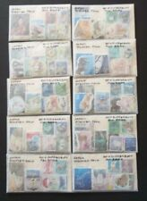 Used lot of 600 mixed all different Japanese stamps off paper - all eras
