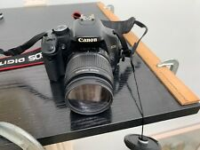 Canon EOS 450D camera with accessory lenses and bag