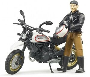 BRU63051 - Moto of Mark Ducati With Figurine Of Color White And Gold