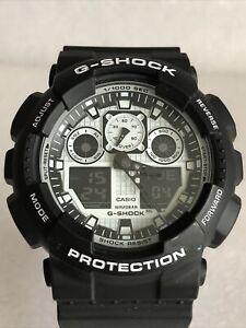 Casio G-Shock GA-100BW-1AER Men's Watch Black Resin Strap White/Black Dial.