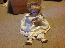 "Baby Doll with Porcelain ? Face, feet and hands.     17""  long.  ANgel win Used."