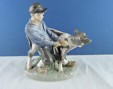 "A Royal Copenhagen Figurine: ""Boy with Calf"" , by Christian Thomesen, 1958"