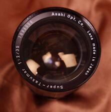 M42 Asahi Pentax Super Takumar 35mm f2.0 + caps