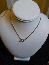 Quirky pretty delicate silver metal box chain + twist knot pendant.