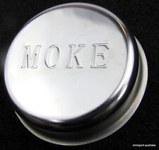 Moke sunraysia wheel cap- stamped with the word 'MOKE'
