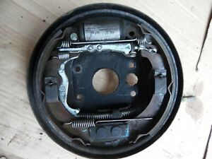 2011 NISSAN PIXO REAR DRIVERS RIGHT BACK PLATE WITH BRAKES