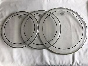 Set of Remo Weatherking pinstripe batter drum heads, 12, 13 and 16.