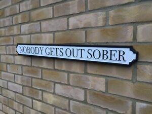 Nobody gets out sober lightweight metal wall sign 80cm long