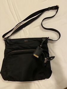 TUMI Voyageur Crossbody Nylon Purse with Gold details. Lots of Zippered Pockets