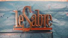 """Buick """"Le Sabre"""" Emblem, Vintage Metal Script, 1964 #7580914"""