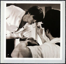 THE BEATLES POSTER PAGE . 1964 JOHN LIGHTS GEORGE'S CIGGY . H30