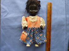 Vintage Ten Inch Black Celluloid Doll in Vintage Clothing