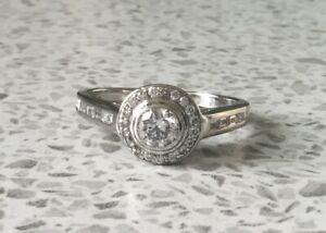 PLATINUM ROUND DIAMOND HALO CLUSTER RING