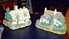 Pair of heavy resin stone houses country style. 1 white cottages 2 story with a