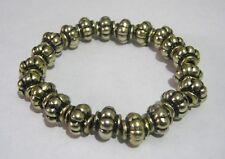 Lovely gold tone plastic beaded elasticated bracelet
