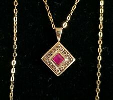 9ct Yellow Gold Pendant & necklace. Set with a Ruby & Brilliant cut Diamonds