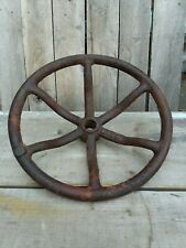 Old rusty primitive hatch wheel iron water valve flume dam control