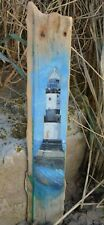 Lighthouse painting on driftwood