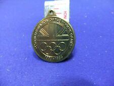 vtg badge medal olympic commemorative 1896 1984 long jump tokyo cereal premium ?