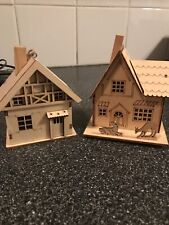 Pair Of Small Wooden Houses